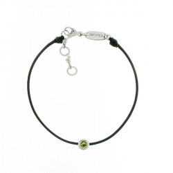 Black cord bracelet with its green peridot stone in a silver close set by Elsa Lee Paris