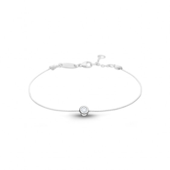 Clear Spirit bracelet from Elsa Lee Paris: one close set Cubic Zirconia 0,2ct on a white cotton waxed lace