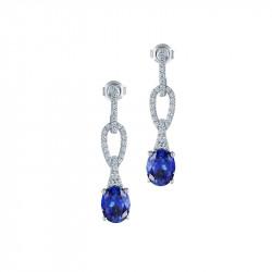 Boucles d'oreilles pendantes Elsa Lee Paris en Argent. Pierres bleues avec pavage en oxydes de Zirconium blancs sur la monture