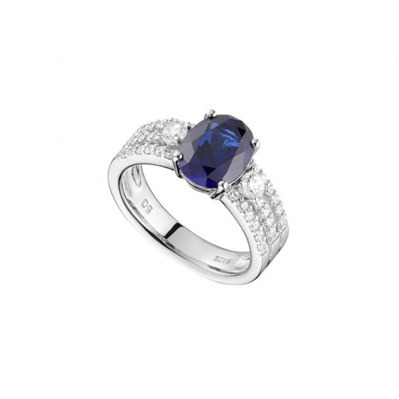 Rhodium coated silver ring with white sapphire blue stone and zirconia