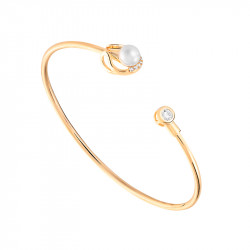 White pearl and yellow gold bangle in semi-open shape by Elsa Lee