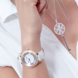 White leather strap watch with roman numerals and rose gold bezel