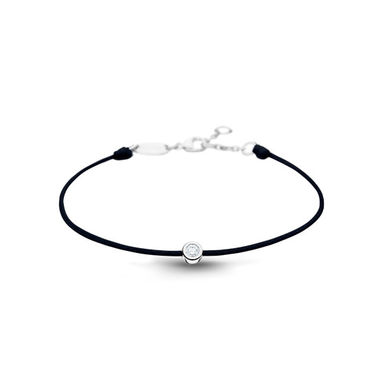 Clear Spirit bracelet from Elsa Lee Paris: one close set Cubic Zirconia 0,2ct on a black cotton waxed lace